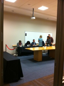 Justin and the other panelists autographing books